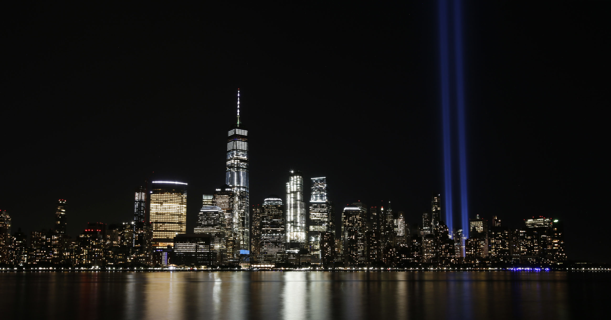 In this Sept. 11, 2017, file photo, the Tribute in Light illuminates the sky above the Lower Manhattan area of New York. The 9/11 terror attacks' 19th anniversary will be marked on Sept. 11, 2020, by dueling ceremonies at the Sept. 11 Memorial Plaza and a corner nearby in New York.