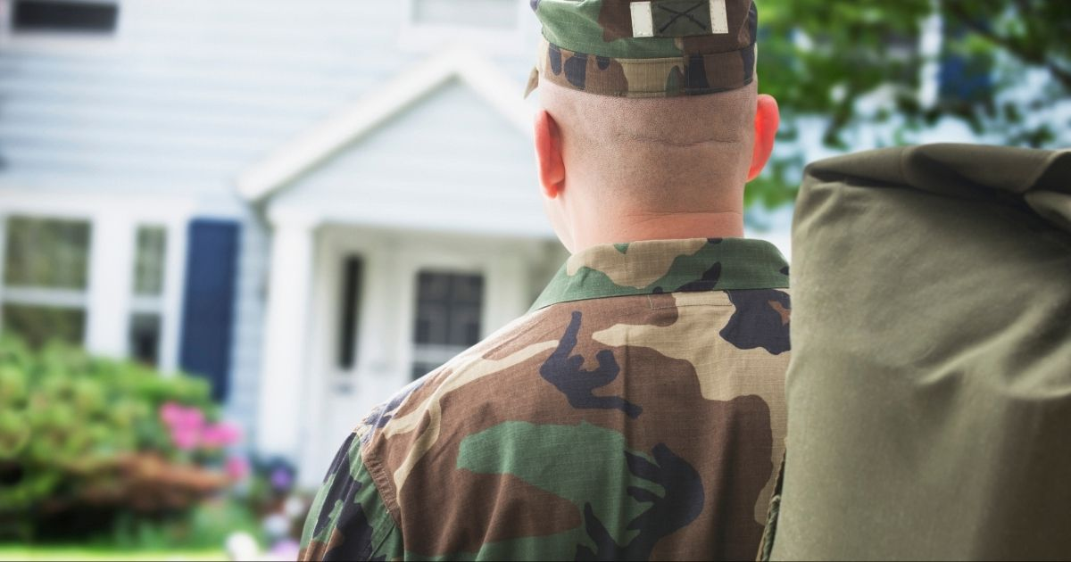 A soldier returns home in the above stock photo.