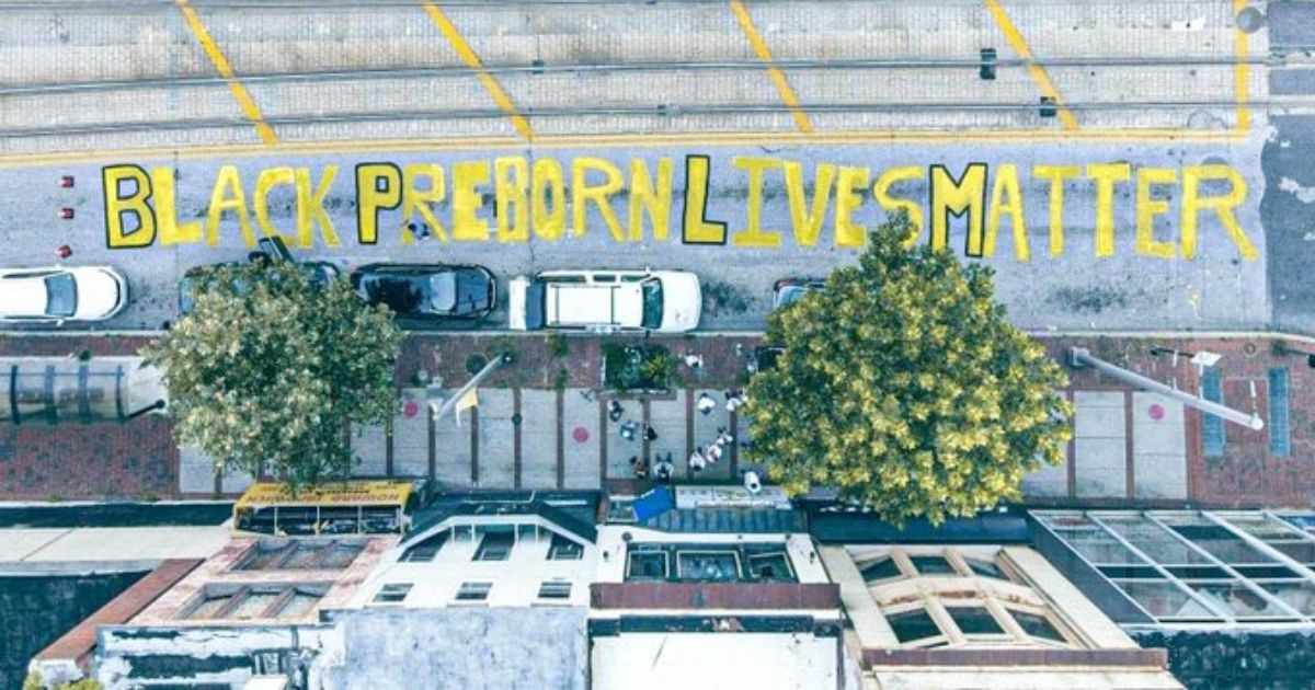 """Students for Life painted """"Black Preborn Lives Matter"""" in the street outside a Baltimore Planned Parenthood clinic."""