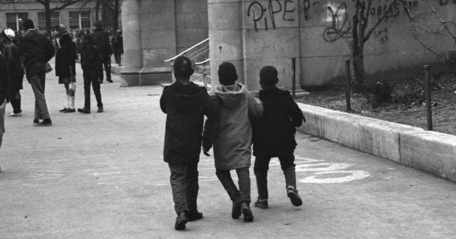 Three children walk to school in the South Side neighborhood of Chicago in 1968.