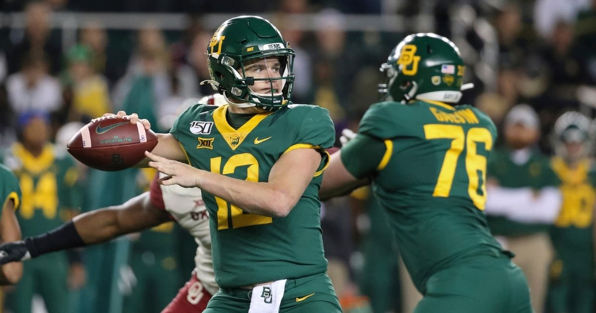 In this Nov. 16, 2019, file photo, Baylor quarterback Charlie Brewer (12) looks for a receiver during the first half of the team's NCAA college football game against Oklahoma in Waco, Texas.