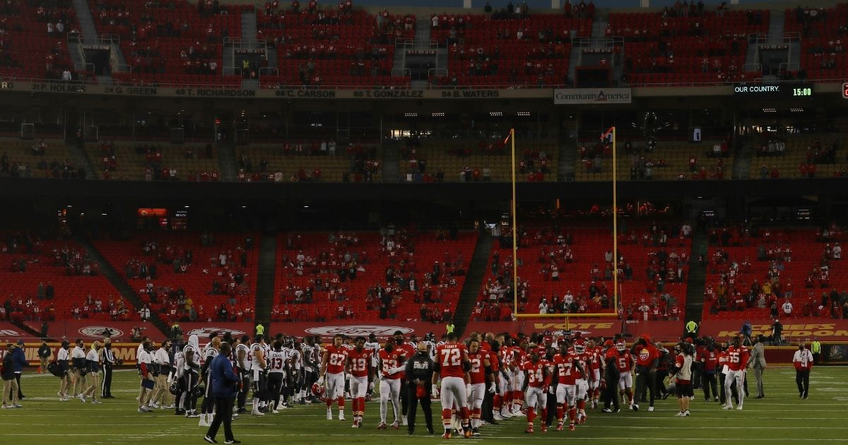 Players from the Kansas City Chiefs and Houston Texans unite in a moment of silence before the start of a game at Arrowhead Stadium on Sept. 10, 2020, in Kansas City, Missouri.