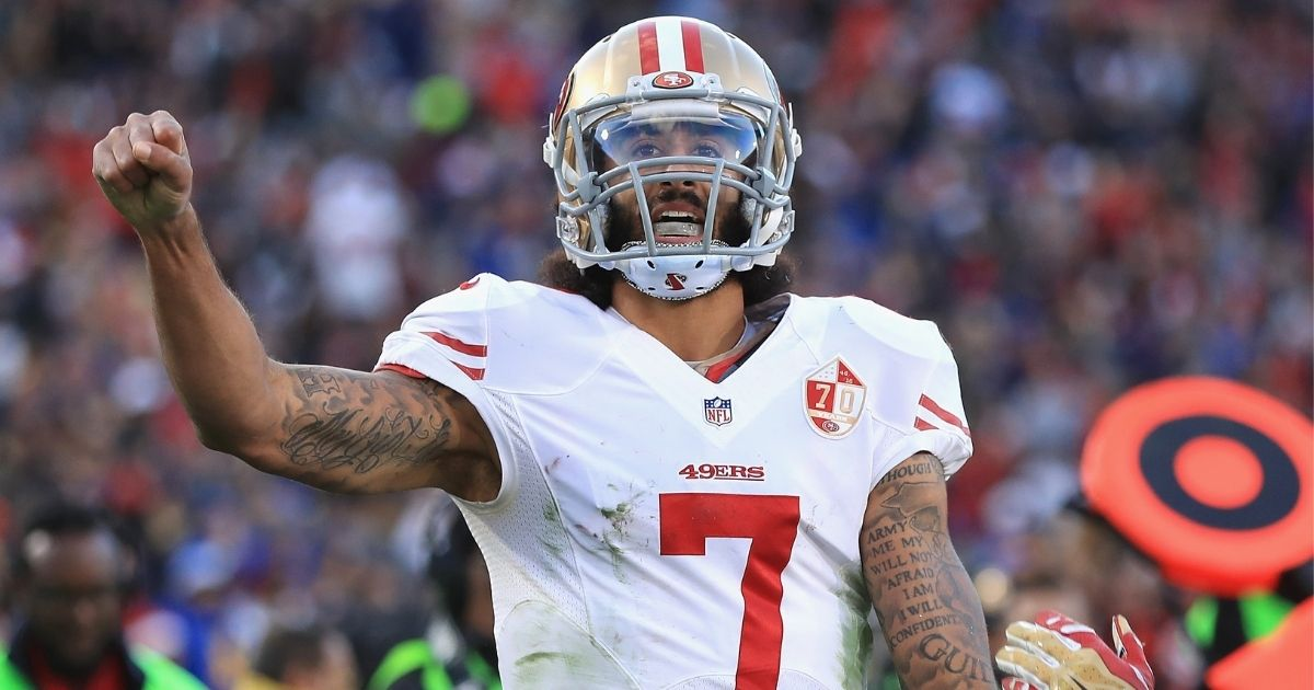 Colin Kaepernick celebrates after scoring a touchdown for the San Francisco 49ers against the Los Angeles Rams at Los Angeles Memorial Coliseum on Dec. 24, 2016.