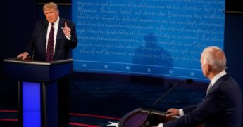 President Donald Trump makes a point as Democratic presidential candidate former Vice President Joe Biden looks on during the first presidential debate Tuesday at Case Western University and Cleveland Clinic in Cleveland, Ohio.