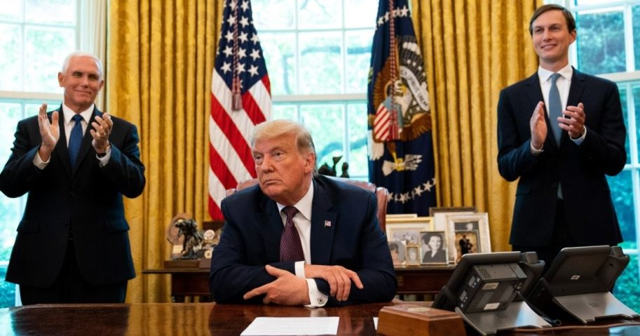 President Donald Trump, flanked by Vice President Mike Pence, left, and senior adviser Jared Kushner, speaks in the Oval Office on Sept. 11, 2020, to announce that Bahrain will establish diplomatic relations with Israel.