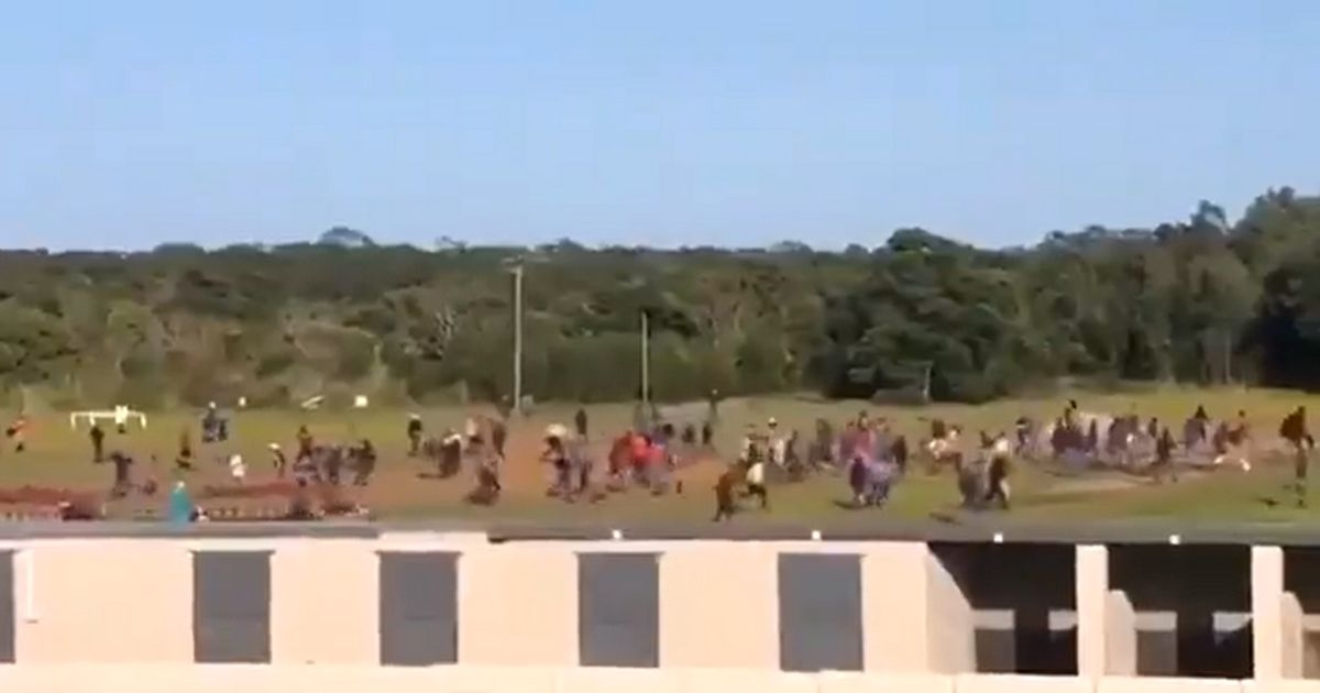 Demonstrators storm the Fairview Race Course in Port Elizabeth, South Africa.