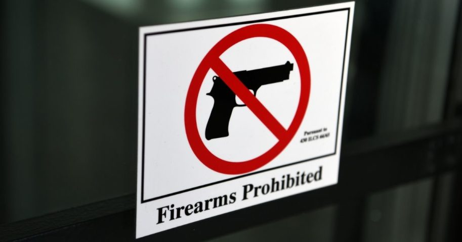 "A ""firearms prohibited"" sign is shown in the above stock photo."