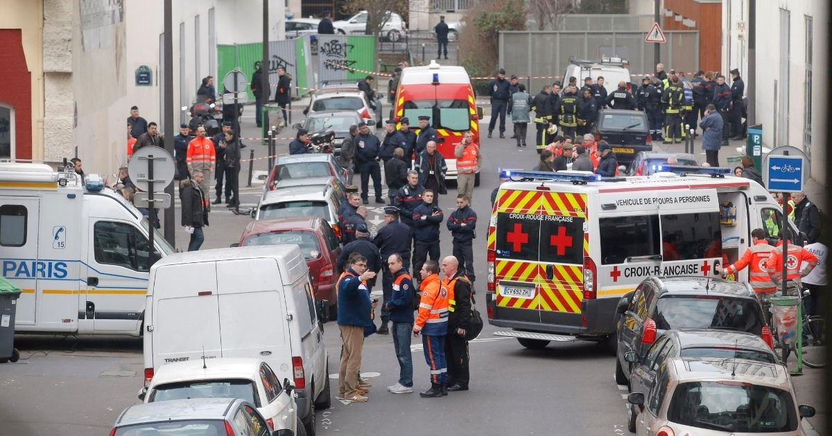 Ambulances are seen in the street outside the Paris office of the French satirical newspaper Charlie Hebdo on Jan. 7, 2015.