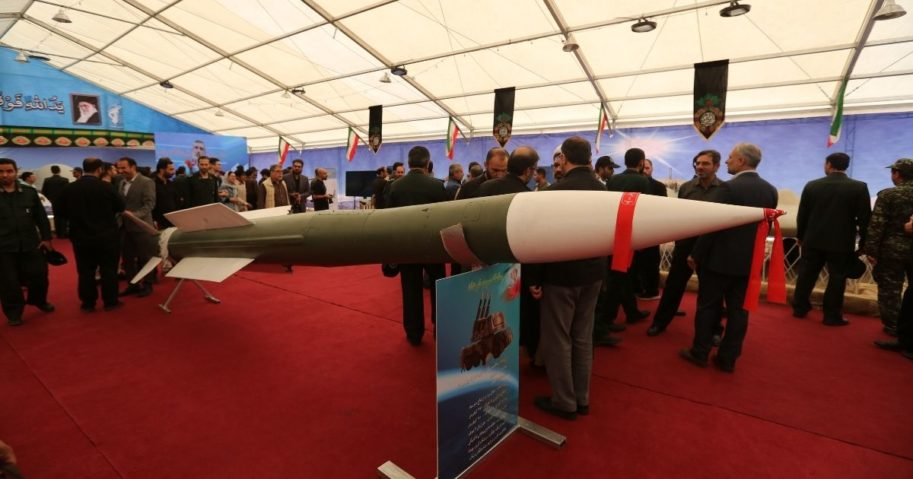 Visitors gather around a missile of the 3-Khordad missile system, at Tehran's Islamic Revolution and Holy Defense museum, during the unveiling of an exhibition of what Iran says are U.S. and other drones captured in its territory, in the Iranian capital Tehran on Sept. 21, 2019.