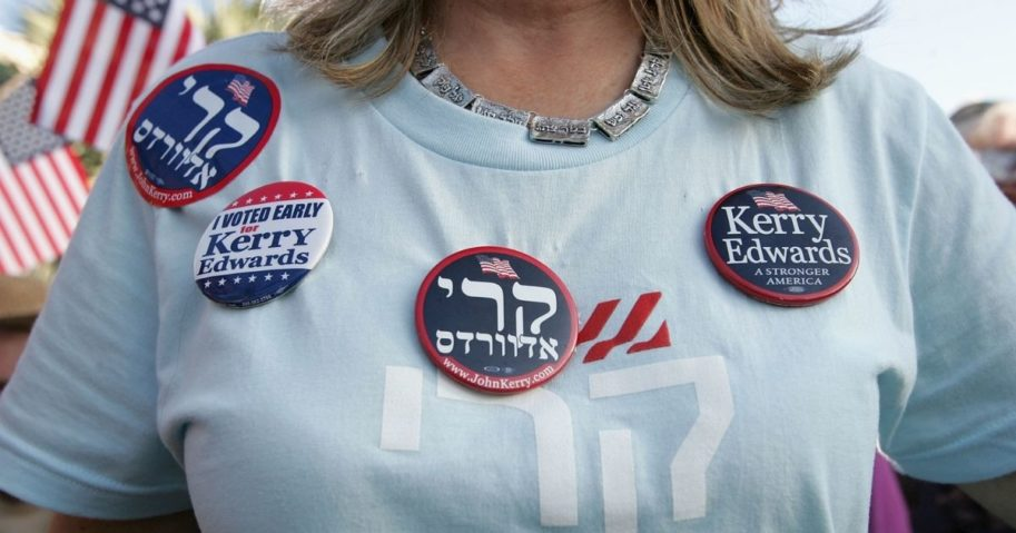 A woman wears a campaign shirt and buttons written in Hebrew supporting democratic presidential candidate John Kerry during a rally at Florida Atlantic University on Oct. 24, 2004, in Boca Raton, Florida.