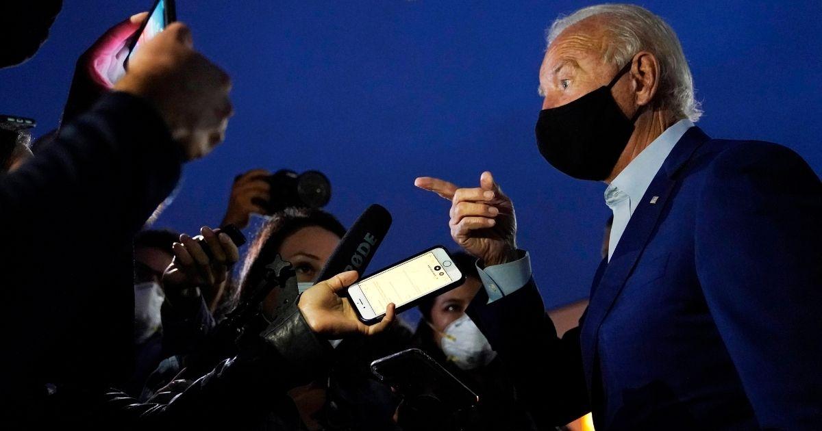 Democratic presidential nominee Joe Biden speaks with reporters before boarding a plane at Detroit Metropolitan Wayne County Airport in Detroit on Sept. 9, 2020.