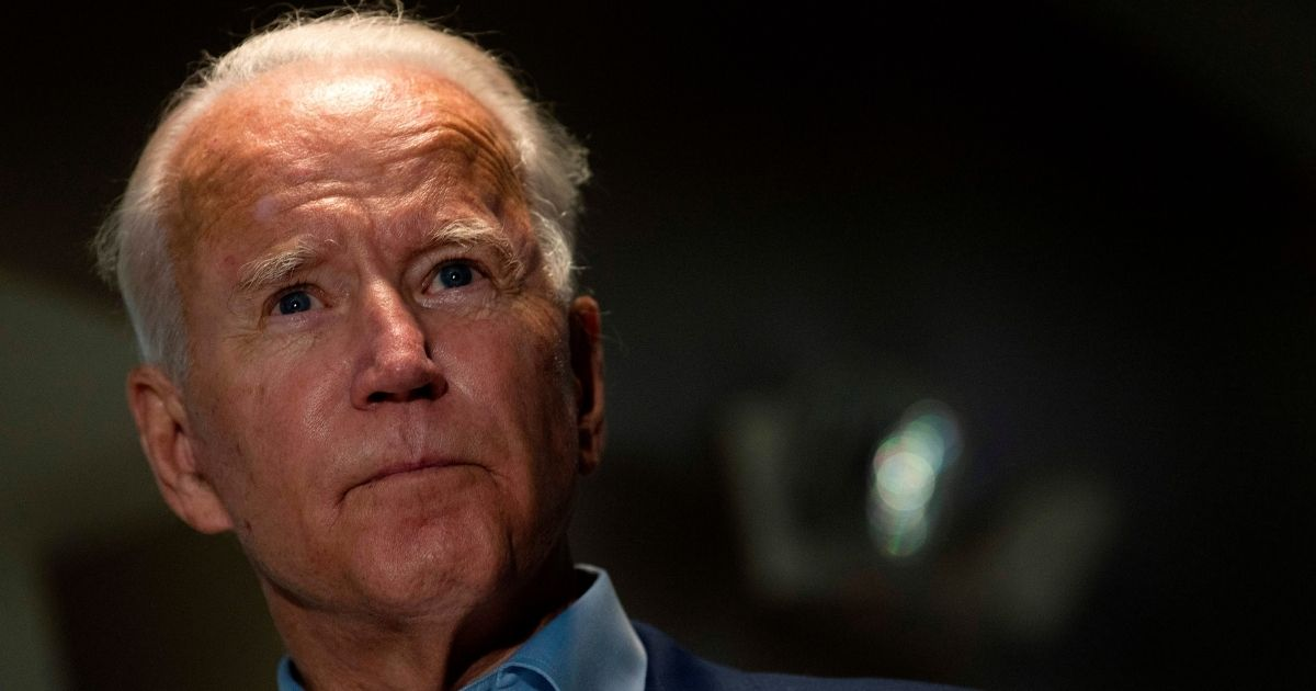 Democratic presidential candidate Joe Biden delivers a statement on the death of Supreme Court Justice Ruth Bader Ginsburg upon landing in New Castle, Delaware, on Sept. 18, 2020.