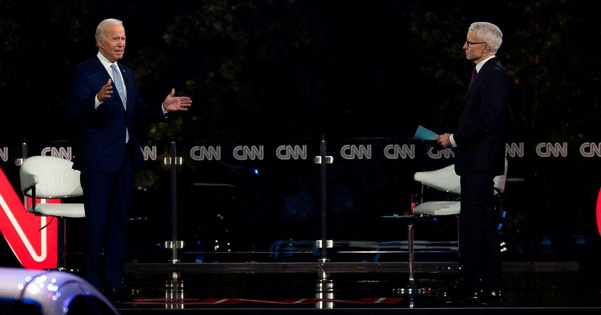 Democratic presidential candidate Joe Biden, left, speaks alongside journalist Anderson Cooper during a CNN drive-in town hall meeting in Scranton, Pennsylvania, on Sept. 17, 2020.