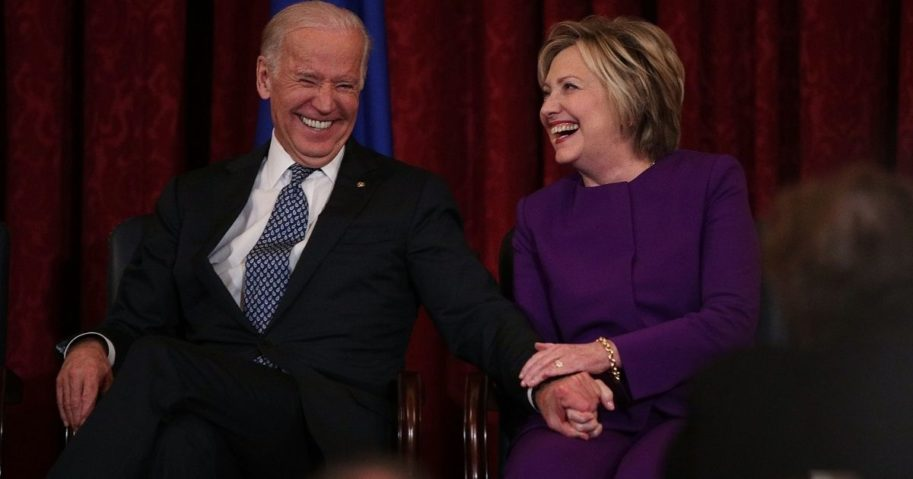Former Secretary of State Hillary Clinton, right, shares a moment with Vice President Joseph Biden during a leadership portrait unveiling ceremony for Senate Minority Leader Sen. Harry Reid on Dec. 8, 2016, on Capitol Hill in Washington, D.C.