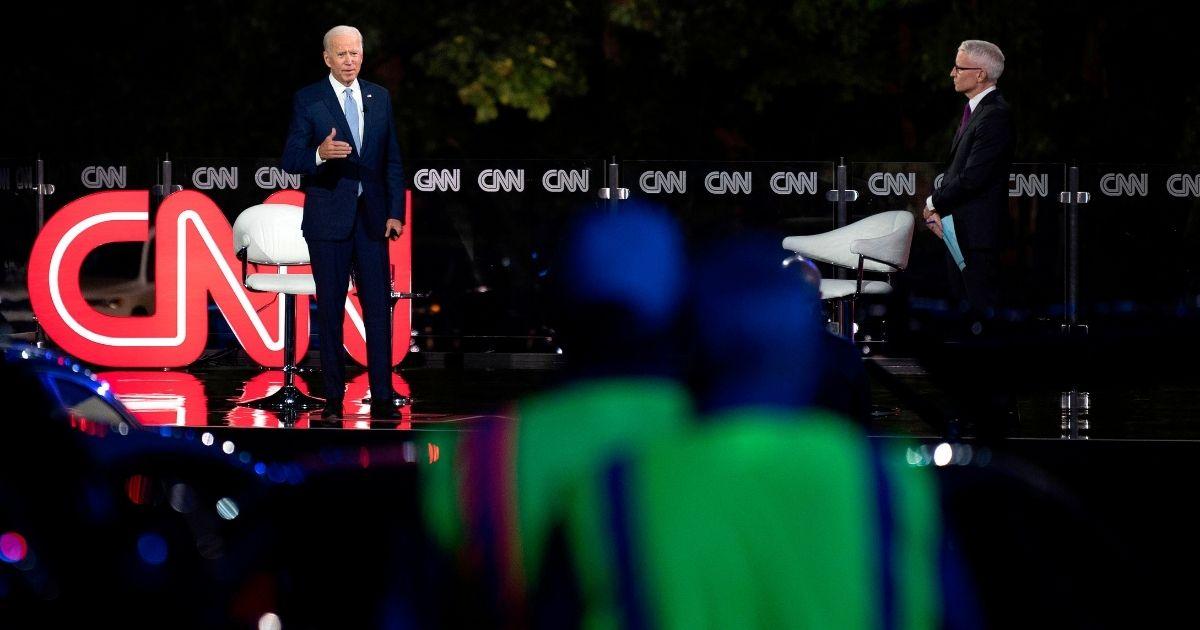 Democratic presidential candidate Joe Biden, left, speaks alongside journalist Anderson Cooper during a CNN drive-in Town Hall meeting in Scranton, Pennsylvania, on September 17, 2020.