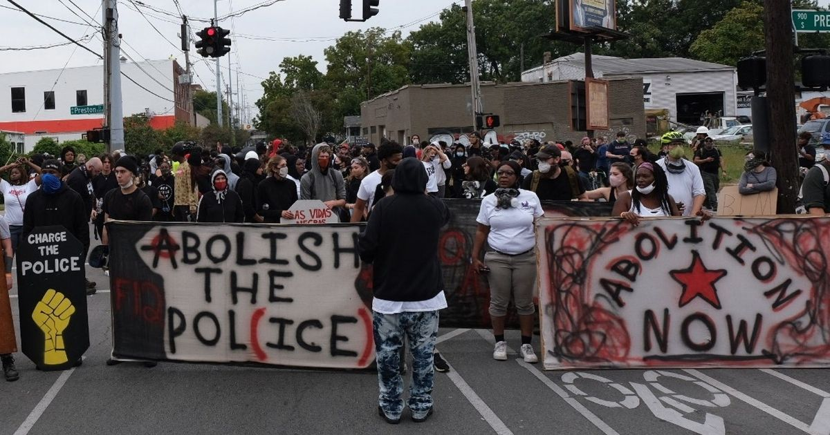 Anti-police protesters march in Louisville, Kentucky, on Sept. 23, 2020.