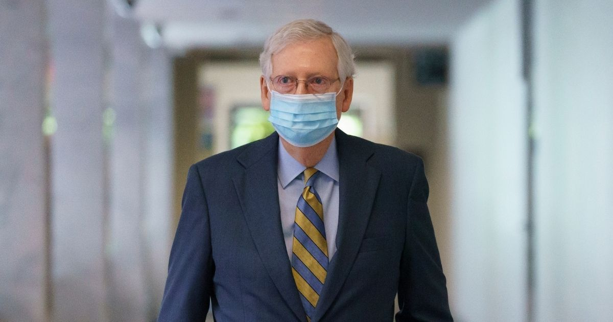 Senate Majority Leader Mitch McConnell arrives to meet with reporters following a Republican strategy session at the Capitol in Washington, D.C., on Sept. 22, 2020.
