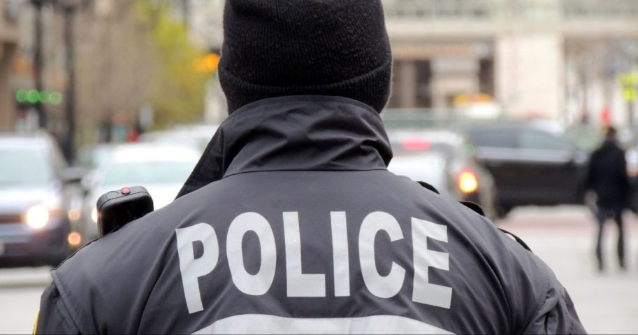A policeman is shown standing in front of traffic in the above stock photo.