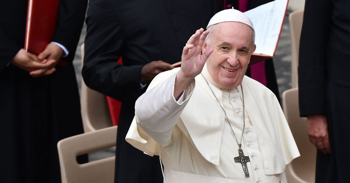 Pope Francis waves at attendees in the Vatican on Sept. 2, 2020.