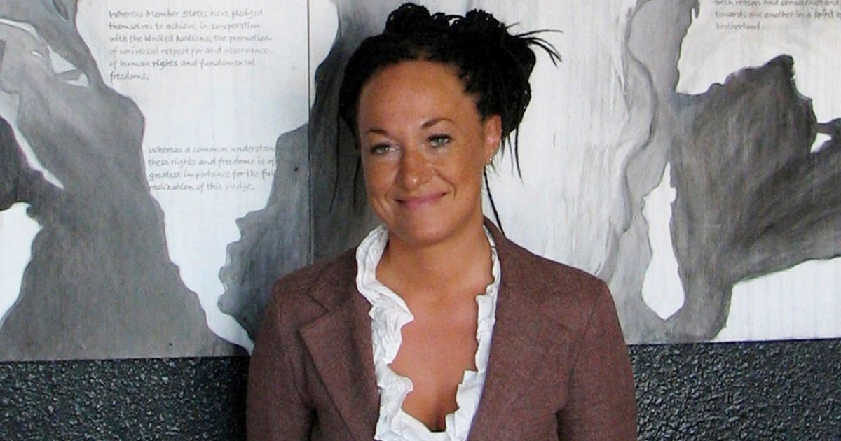 Rachel Dolezal, a white woman who became famous for pretending she was black, stands in front of a mural she painted in Coeur d'Alene, Idaho.