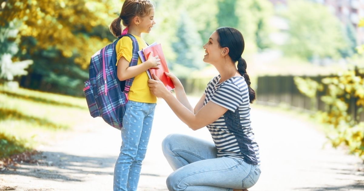In the stock image above, a mother prepares her daughter for the first day of school.