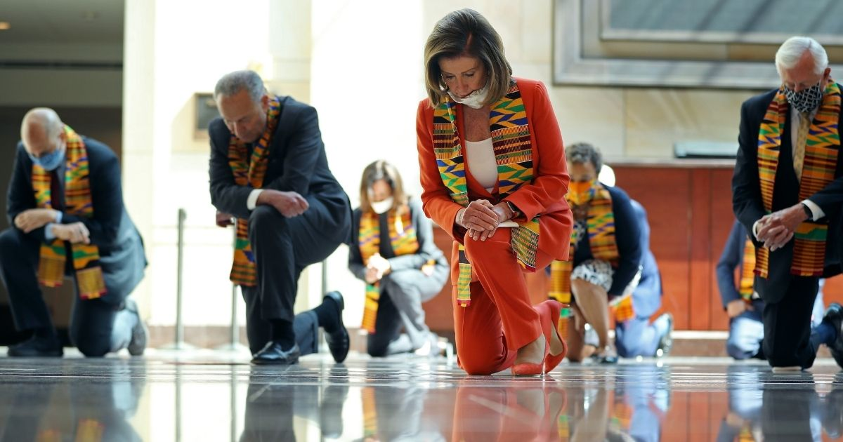 Speaker of the House Nancy Pelosi joins other Democratic lawmakers from the House and Senate to kneel in silence for eight minutes and 46 seconds to honor George Floyd in the U.S. Capitol Visitors Center on June 8, 2020, in Washington, D.C.