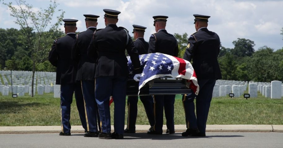 Members of the U.S. Army's 3rd Infantry Regiment carry the flag-draped casket of World War II Army veteran Carl Mann to his final resting place during his funeral on the 75th anniversary of the D-Day invasion on June 6, 2019, at Arlington National Cemetery in Arlington, Virginia.