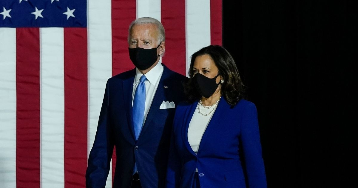 Democratic presidential nominee former Vice President Joe Biden and his running mate, California Sen. Kamala Harris, arrive to deliver remarks at the Alexis Dupont High School on Aug. 12, 2020, in Wilmington, Delaware.