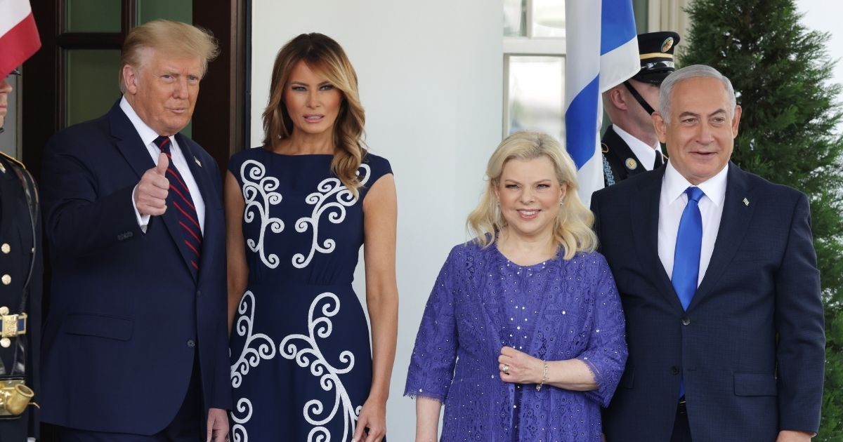 President Donald Trump, accompanied by first lady Melania Trump, gives a thumbs up to cameras on Tuesday before a historic signing ceremony between Israel, Bahrain and the United Arab Emirates at the White House. With the Trumps are Israeli Prime Minister Benjamin Netanyahu and his wife, Sara.