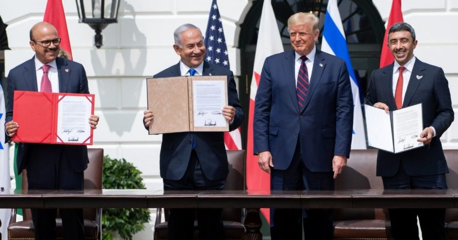 From left to right, Bahrain Foreign Minister Abdullatif al-Zayani, Israeli Prime Minister Benjamin Netanyahu, U.S. President Donald Trump and UAE Foreign Minister Abdullah bin Zayed Al-Nahyan hold up documents after participating in the signing of the Abraham Accords, in which the countries of Bahrain and the United Arab Emirates formally recognize Israel, at the White House on Sept. 15, 2020.