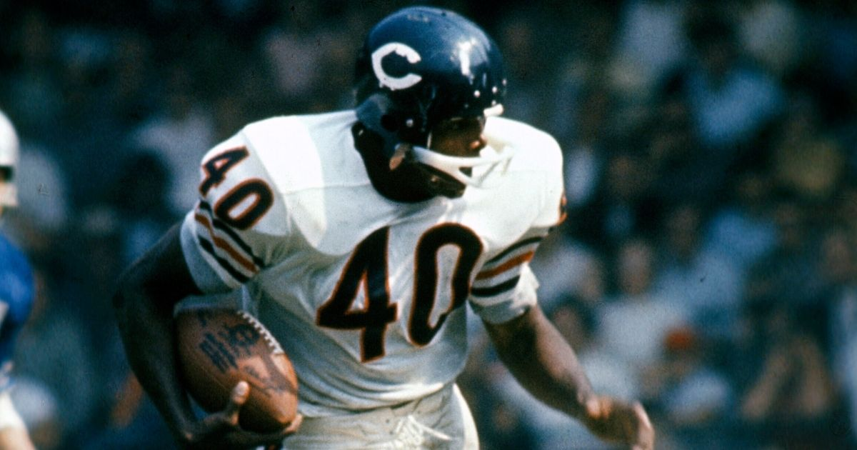 NFL legend Gale Sayers of the Chicago Bears carries the ball against the Detroit Lions during a game in Detroit circa 1965.