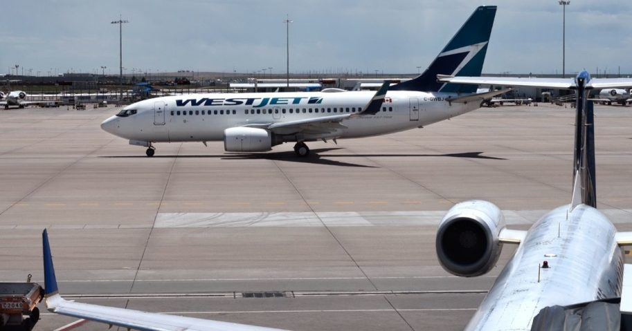 WestJet says it canceled a flight from Calgary to Toronto because a three-year-old did not wear a mask, but the father of the child says otherwise. A WestJet plans is seen in the stock image above.