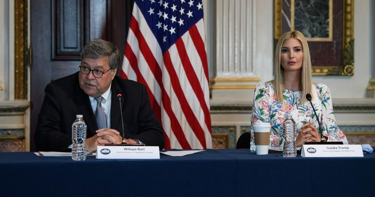 Ivanka Trump, right, daughter of and adviser to President Donald Trump, listens to Attorney General Bill Barr during a meeting on human trafficking at the Eisenhower Executive Office Building in Washington, D.C., on Aug. 4, 2020.