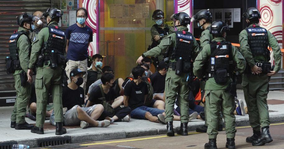 People are arrested by police officers in Hong Kong on Sep. 6, 2020. About 300 people were arrested at protests against the government's decision to postpone elections for Hong Kong's legislature, police and a news report said.