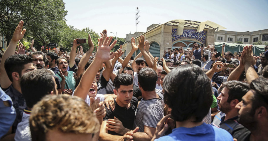 In this June 25, 2018, file photo, a group of protesters chant slogans in Tehran, Iran.