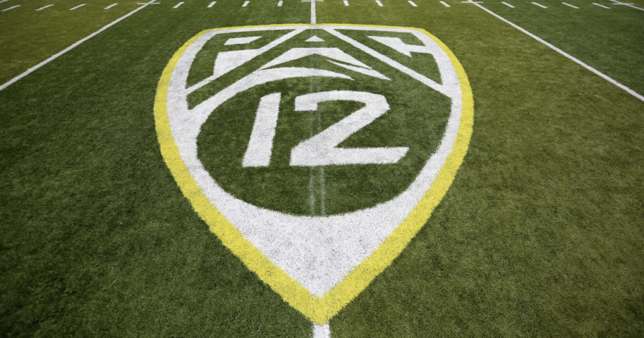 In this Oct. 10, 2015, file photo, a Pac-12 logo is displayed on the field before an NCAA college football game between Washington State and Oregon in Eugene, Oregon.