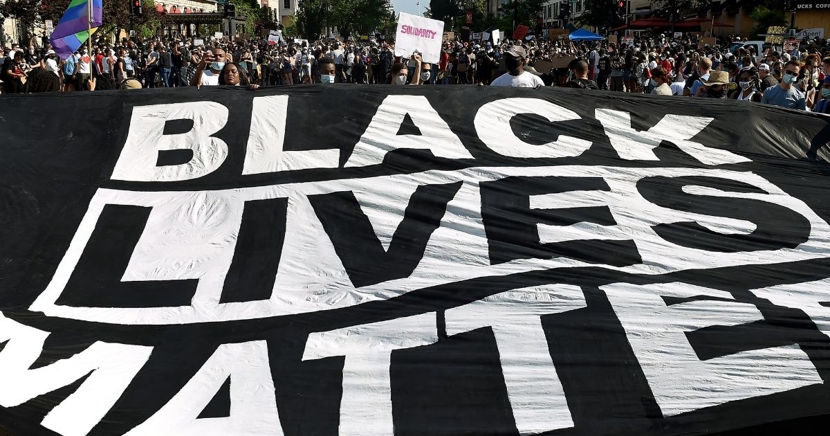 "Protesters display a ""Black Lives Matter"" banner near the White House during a demonstration in Washington, D.C., on June 6, 2020."