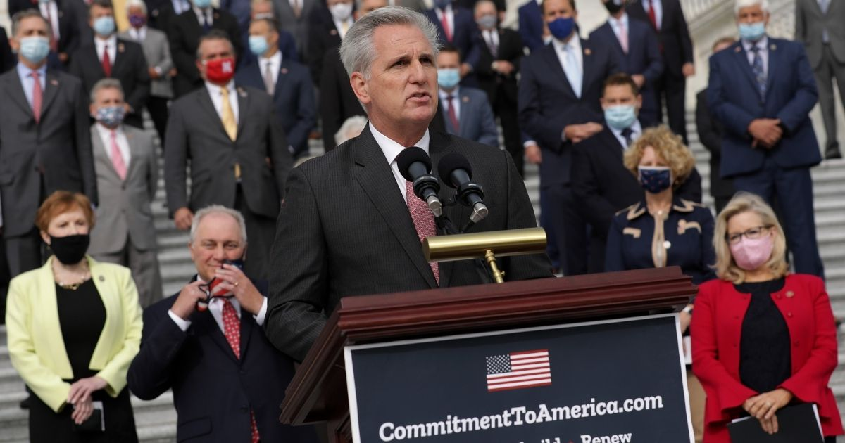 """House Minority Leader Kevin McCarthy is joined by fellow House Republicans while introducing their proposed legislative agenda, the """"Commitment to America,"""" on Sept. 15, 2020, in Washington, D.C."""