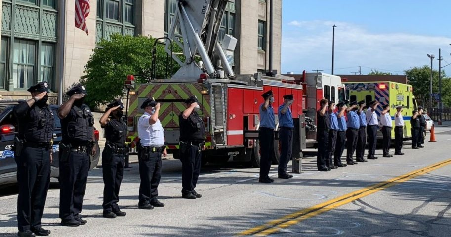 First responders stand at attention as the body of James Skernivitz, 53, is taken to a funeral home. Skernivitz was killed in the line of duty on Sep. 3, 2020, in Cleveland, Ohio.
