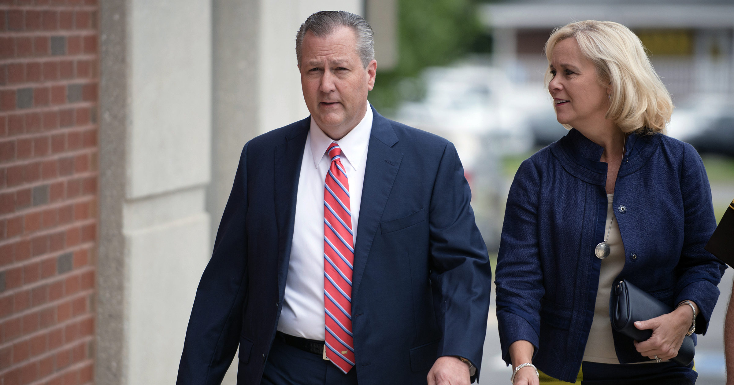 In this Sept. 2, 2016, file photo, Mike Hubbard, former Alabama Speaker of the House, and his wife, Susan, arrive for a hearing at the Lee County Justice Center in Opelika, Alabama. Mike Hubbard reported Sept. 11, 2020, to a county detention center to begin the sentence after an unsuccessful effort to overturn his ethics conviction.