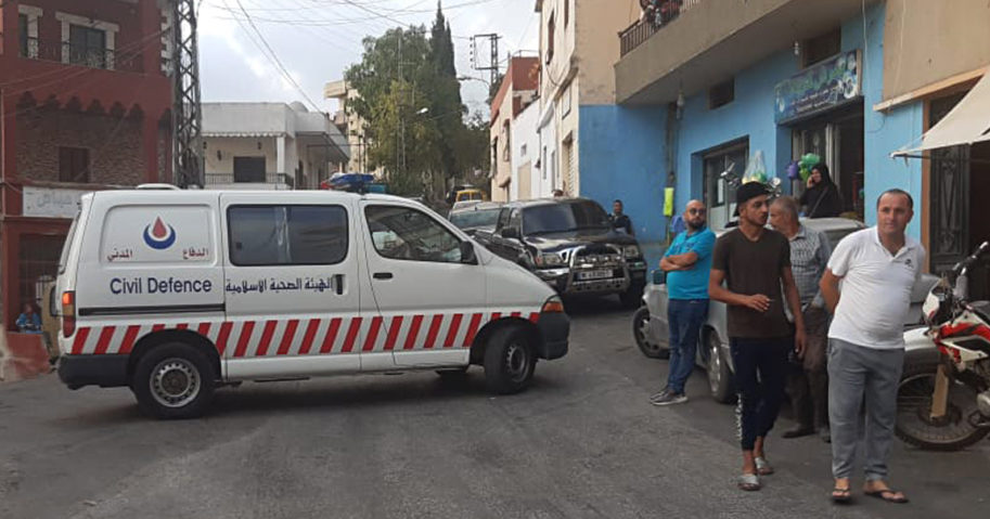A Hezbollah ambulance blocks a road that leads to the site of an explosion in the village of Ain Qana, Lebanon, on Sept. 22, 2020.