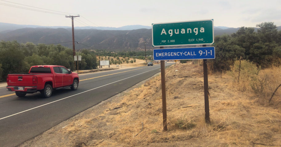 Traffic passes along State Route 371 entering the town of Aguanga, California, on Sep. 8, 2020.
