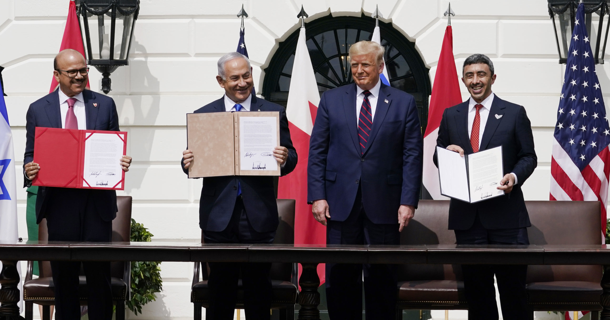 Bahrain Foreign Minister Khalid bin Ahmed Al Khalifa, Israeli Prime Minister Benjamin Netanyahu, US President Donald Trump and United Arab Emirates Foreign Minister Abdullah bin Zayed al-Nahyan attend the Abraham Accords signing ceremony on the South Lawn of the White House on Sept. 15, 2020, in Washington, D.C.