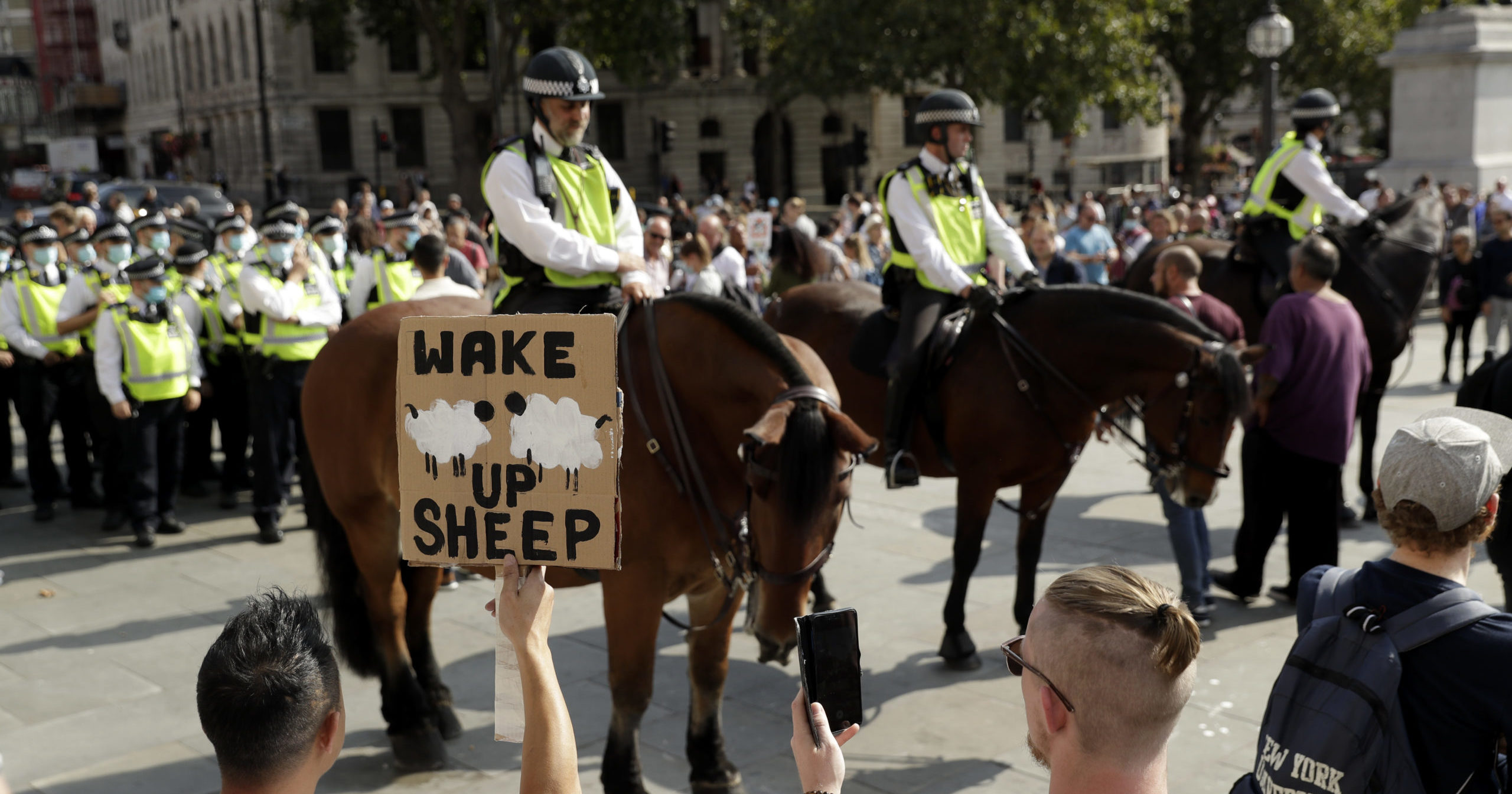 Demonstrators took to the streets of London, Tel Aviv and other cities on Sept. 19, 2020, to protest coronavirus restrictions, decrying the government mandates that have upended daily life around the globe.