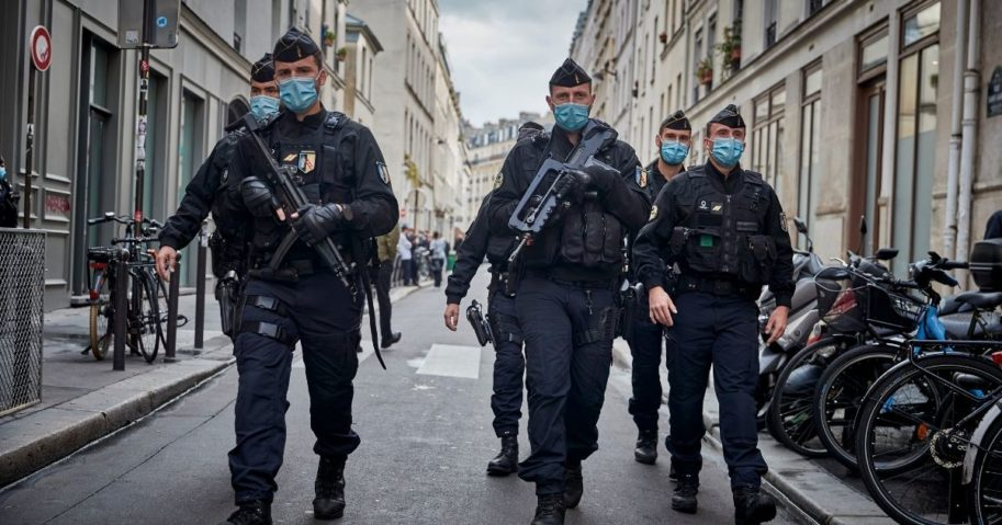 Police secure the area around the former Charlie Hebdo headquarters, the scene of a 2015 terrorist attack, after two people were stabbed on Sept. 25, 2020, in Paris.