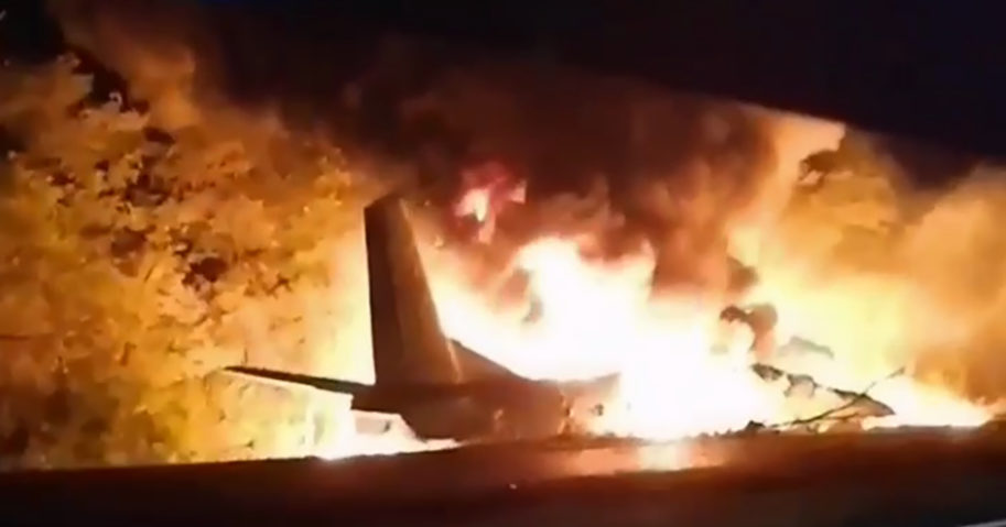 In this image from footage released by Ukraine's Emergency Situation Ministry, an AN-26 military plane bursts into flames after crashing in the town of Chuguyiv, Ukraine, on Sept. 25, 2020. Twenty-six people were killed.