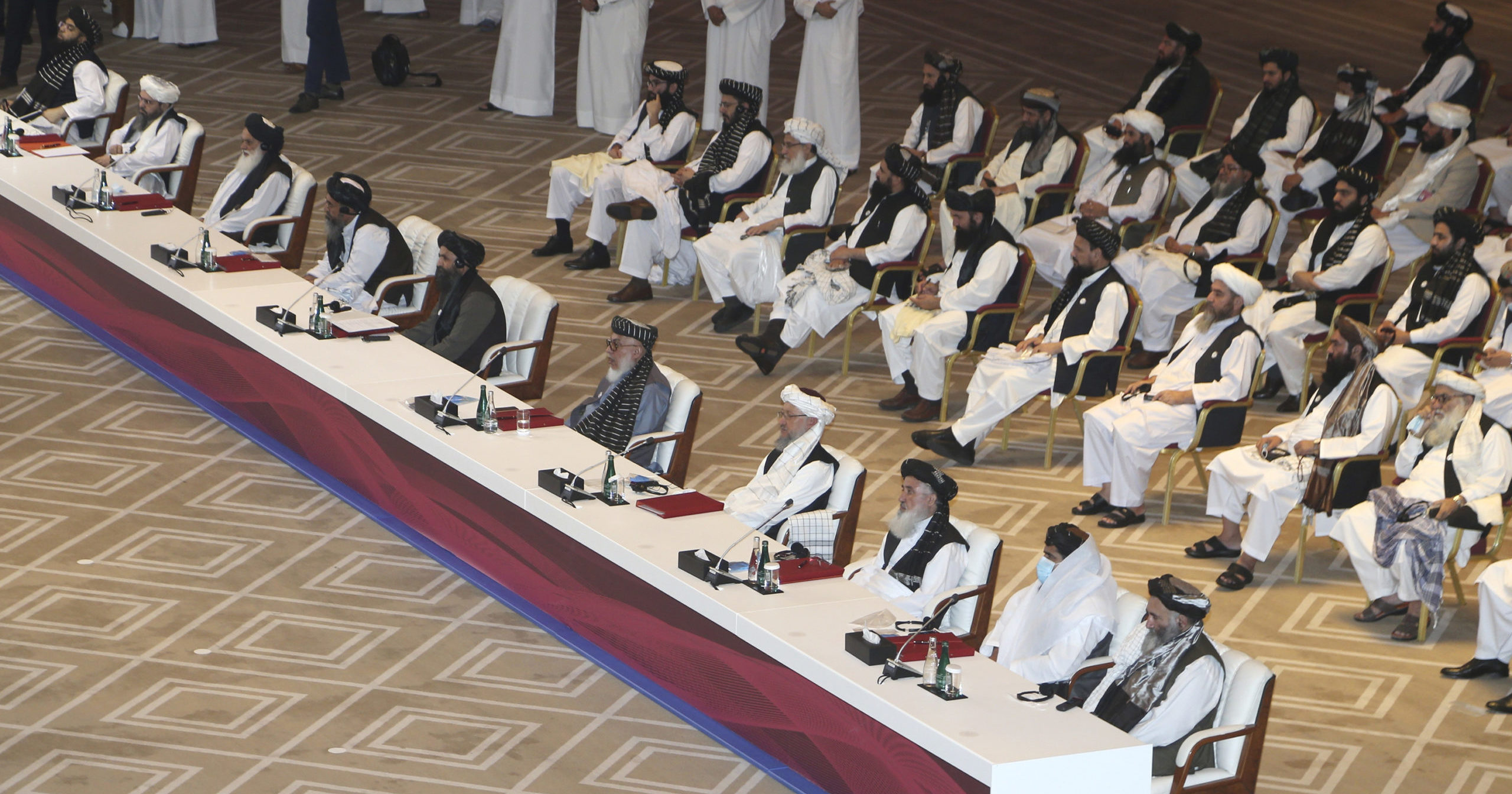 Taliban negotiators attend the opening session of the peace talks between the Afghan government and the Taliban in Doha, Qatar, on Sept. 12, 2020.