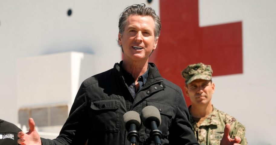 California Gov. Gavin Newsom speaks in front of the hospital ship USNS Mercy at the Port of Los Angeles on March 27, 2020.