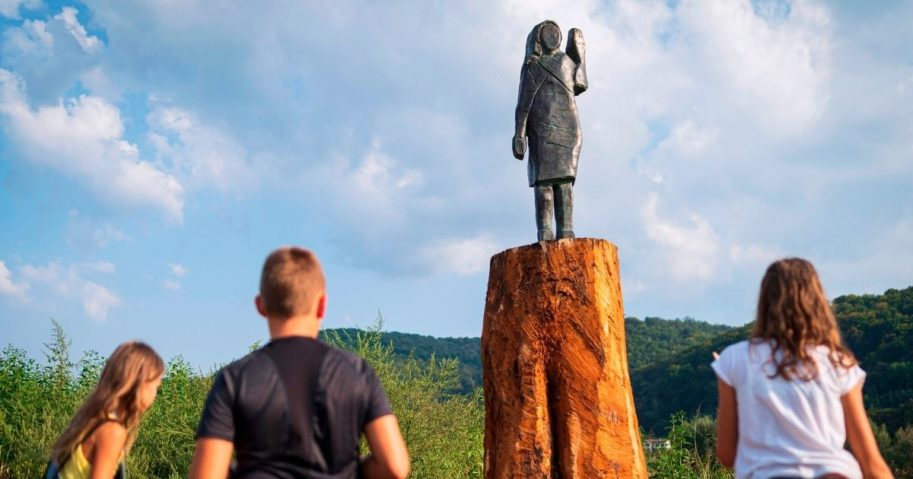 Children look at a bronze statue depicting US First Lady Melania Trump after its unveiling in a field near Trump's hometown of Sevnica, Slovenia, on Sept. 15, 2020. The statue is a replica of an original wooden statue which was burned by unknown perpetrators on July 5, 2020.