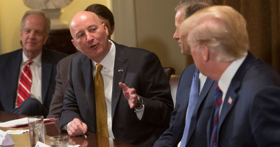 Nebraska Governor Pete Ricketts speaks to President Donald Trump during a meeting on trade with governors and members of Congress at the White House on April 12, 2018, in Washington, D.C.